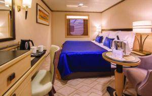 Cunard-Queen Mary 2-schip-Cruiseschip-Categorie HB-Atriumzicht Binnenhut